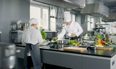 two chefs in kitchen