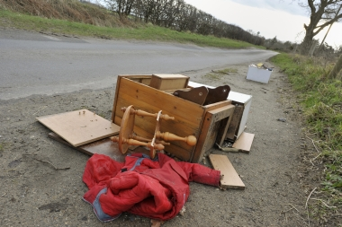 discarded household items lying at side of road